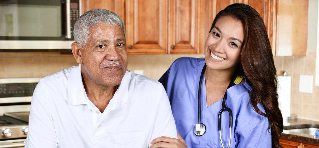 attractive nurse holding senior man while smiling
